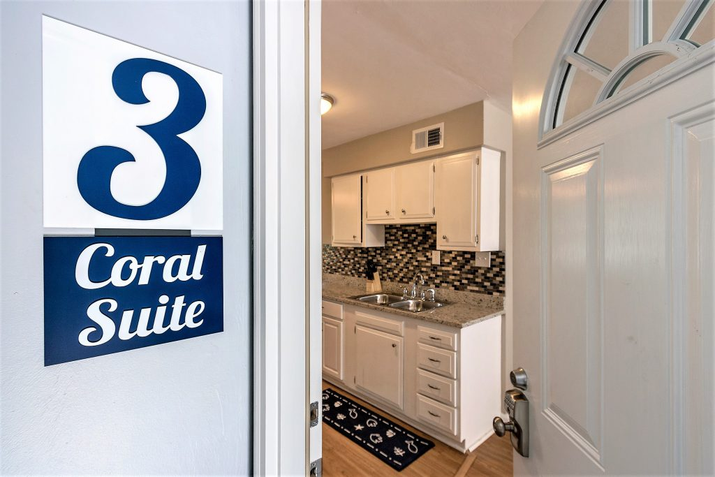 looking through the doorway of Coral Suite #3 into the kitchen