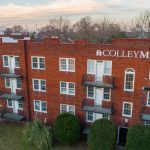 red brick apartment building with Colley Manor written on it